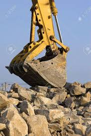 100 Rock Trucks Large Track Hoe Being Used To Fill Dump With To Be