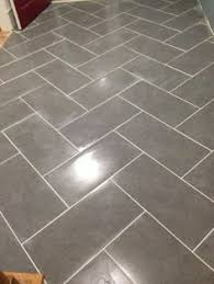 mitte gray tile grout color shop style selections mitte gray glazed porcelain floor tile