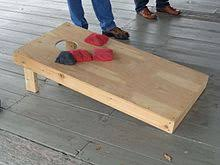 A Typical Cornhole Board With Two Colors Of Bag
