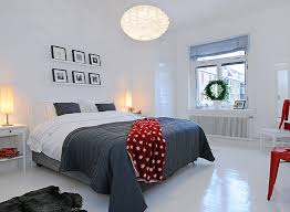 Minimalist White And Grey Bedroom With Bold Red