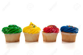 Various colored cupcakes on a white background Stock