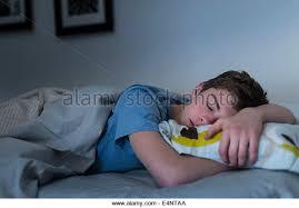 teenage boy sleeping in bed stock photos teenage boy sleeping in