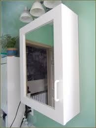 white medicine cabinet with mirror and lights oxnardfilmfest