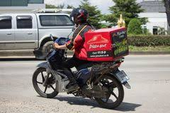 Delivery Service Man Ride A Motercycle Of Pizza Hut Company CHIANG MAI THAILAND