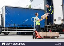 Two Men Unloading Cardboard Boxes From Truck Stock Photo: 50015509 ... Two Men And A Truck Columbus Ohio On Vimeo Core Values And What They Mean To Us Veterans In Franchising 2017 Youtube Two Men A Truck Google Headquarters Hobbsblack Architects Movers Drivers Men Unloading Cboard Boxes From Truck Stock Photo 015509 About Our Company The Who Care Award Wning Moving Team And Sacramento Can Day The Life Of Mover