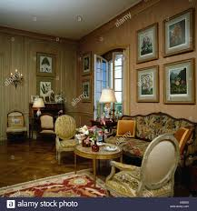 100 Drawing Room Furniture Images Pictures On Wall Above Patterned Sofa In Drawing Room With