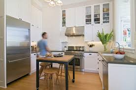 Kitchen Theme Ideas 2014 by Designing Small Kitchens With Modern Big Refrigerator And Sirocco