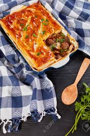 100 Golden Crust Delicious Chunky Meat And Mushroom Pie Topped With Golden Crust