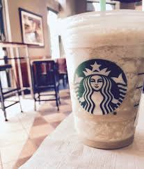 Artistic Photo Of My Coffee Frappuccino Only Slightly Sipped Upon Before The Photograph