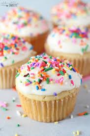 Vanilla cupcakes with vanilla ice cream and rainbow sprinkles