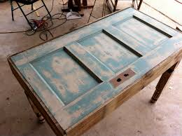 recycled door into table garden furniture