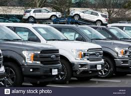 A Row Of New Ford F-series Pick-up Trucks And Explorer SUV's At A ... Ford To Restart Production Of F150 Super Duty After Fire Fortune Unveils New Fseries In Denver Where Truck Industry 2018 Fseries Media Center Isuzu Commercial Vehicles Low Cab Forward Trucks Limited Trim Price Tag Nears 100k F Series A Brief History Autonxt With 4 Wheel Drive Unprecented Achieves 40 Consecutive Years As Brings Production Some To A Halt Gm Stx Returns For My 2017 Now Available On 6 Uncommon Arguments Buying Fordtrucks Sales Numbers Figures Results