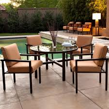 Awesome Affordable Beige Modern Outdoor Furniture Upholstered Chairs Combined With Round Glass Table Decorative Dry Flower