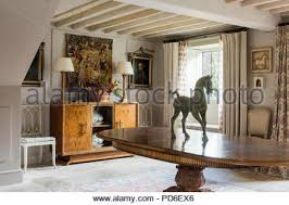 Equestrian Statue On Oval Dining Table In Entrance Hall With Lamps Sideboard