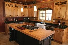Cozy Wood Countertop With Gas Stove And Pendant Lighting For Elegant Kitchen Design Rustic Cabinets