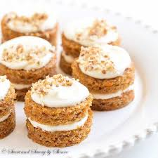 Adorable mini carrot cakes filled with classic cream cheese frosting and studded with crunchy can d pecans