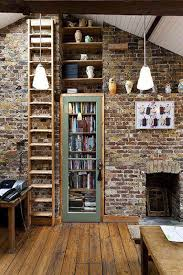 This Wall Of Bricks Is Excellent But The Bookshelves Behind A Door In