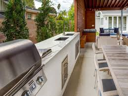 Diy Outdoor Kitchen Pergola With Climbing Plant Feat Built In Grill L Shaped Plan Stainless Steel Storage Doors Natural Pool Design Stone