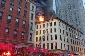 100 Five Story New York Firefighters Battle Large Fire In NYCs Tribeca Neighborhood