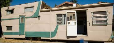 Exterior 1954 Tri Level Mobile Home Before Remodel