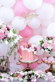 cake display from a pink white gold garden party via kara s