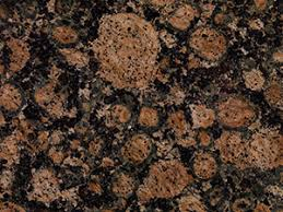 Baltic Brown Granite Consists Of Circular Light Spots Various Sizes Combined With Small And Dark Green Over A Black Background