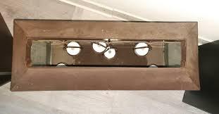 deko wohnzimmer beleuchtung metall glas spiegel