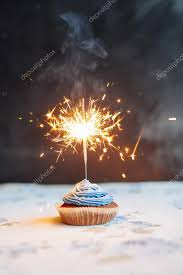 Birthday Cupcake with a sparkler over a blue background — by sibstock
