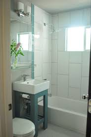 contemporary bathroom with tiled wall showerbath