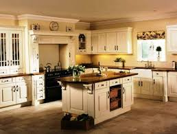 Image Of Cream Kitchen Cabinets With Black Appliances