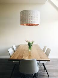 Minimalist Dining Room With IKEA Pendant Light In Copper And White Myhouse