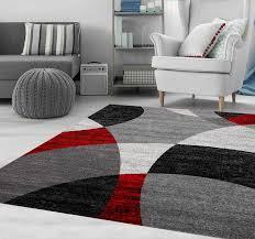 teppich wohnzimmer rot grau schwarz modern kreis gestreift