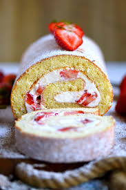 This Strawberry Shortcake Roulade is the quintessential summer dessert Cake rolls are always stunning but