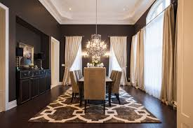 Black Transitional Dining Room With Chandelier White Ceiling And Floor Rug