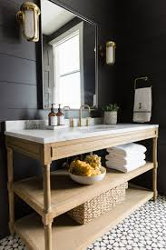 Bathroom Tilt Mirror Hardware by Still Love Charcoal Gray Wood Panels With Antique Gold Sconces