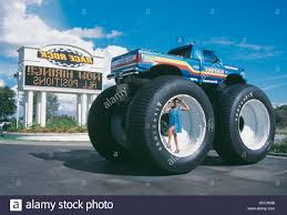 Woman Standing In Big Wheel Of Monster Truck, USA Stock Photo ... 5 Biggest Dump Trucks In The World Red Bull Dangerous Biggest Monster Truck Ming Belaz Diecast Cstruction Insane Making A Burnout On Top Of An Old Sedan Ice Cream Bigfoot Vs Usa1 The Birth Of Madness History Gta Gaming Archive Full Throttle Trucks Amazoncom Big Wheel Beast Rc Remote Control Doors Miami Every Day Photo Hit Dirt Truck Stop For 4 Off Topic Discussions On Thefretboard
