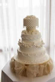 Beautiful rose and swag wedding cake