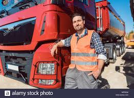 Truck Driver In Front Of His Freight Forward Lorry Stock Photo ...