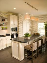 Cream Cabinets Island With Black Countertop Gray White Hexagonal Pattern Wallpaper Dark Wood Flooring 3 Pendant Lights Indoor Tree