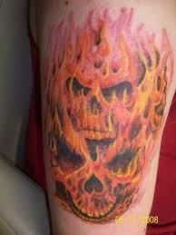 Red And Yellow Evil Flame Skull Tattoo On Half Sleeve