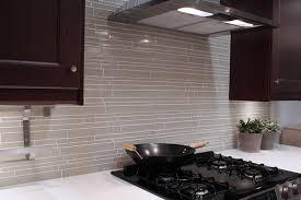light taupe linear glass mosaic tile backsplash modern kitchen