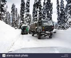 India, Kashmir, Gulmarg, Army Truck With Snow Chains Driving On Snow ...