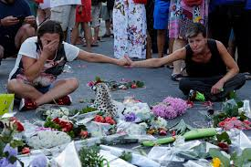 People React Near Flowers Placed On The Road In Tribute To Victims Two Days After