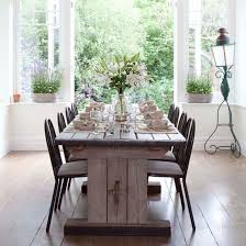 French Inspired Dining Conservatory With Oak Flooring And A Limed Table