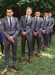 Groomsmen In Dark Grey Suits Navy Ties And Brown Shoes
