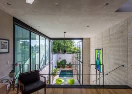 100 Glass Walls For Houses Huge Glass Doors Open Mexican House To A Courtyard Garden