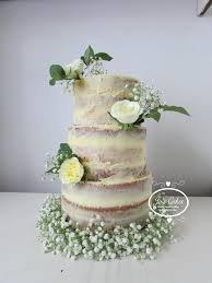 Three Tier Semi Naked Wedding Cake With Fresh Roses And Babys Breath