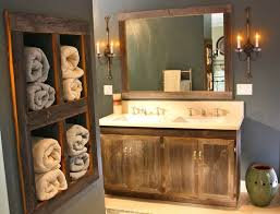 Rustic Bathroom With Towel Storage And Wooden Vanity Also Wall Sconces