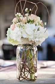 Large Jar Filled With Fresh Flowers Branches And Wrapped Rope Reception Wedding Decor Flower Centerpiece