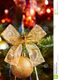 Detail Gold Ball And Ribbon On Christmas Tree